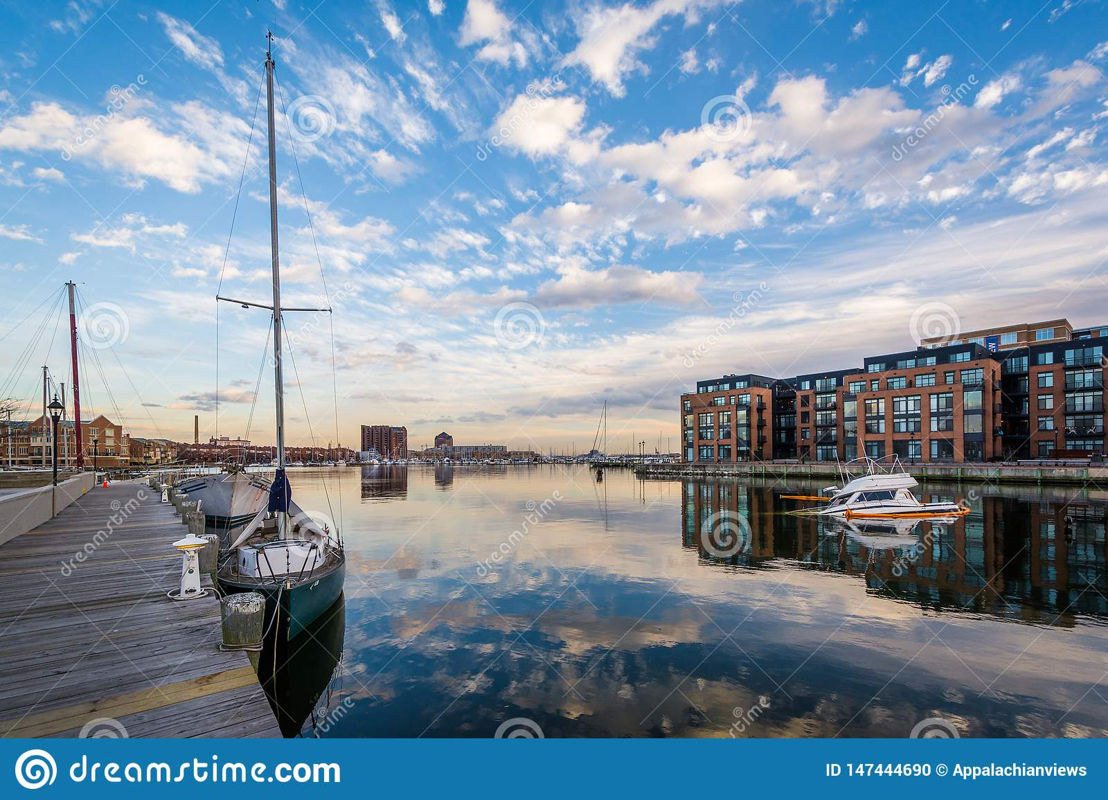 Sunken boat and Union Wharf, in Baltimore, Maryland