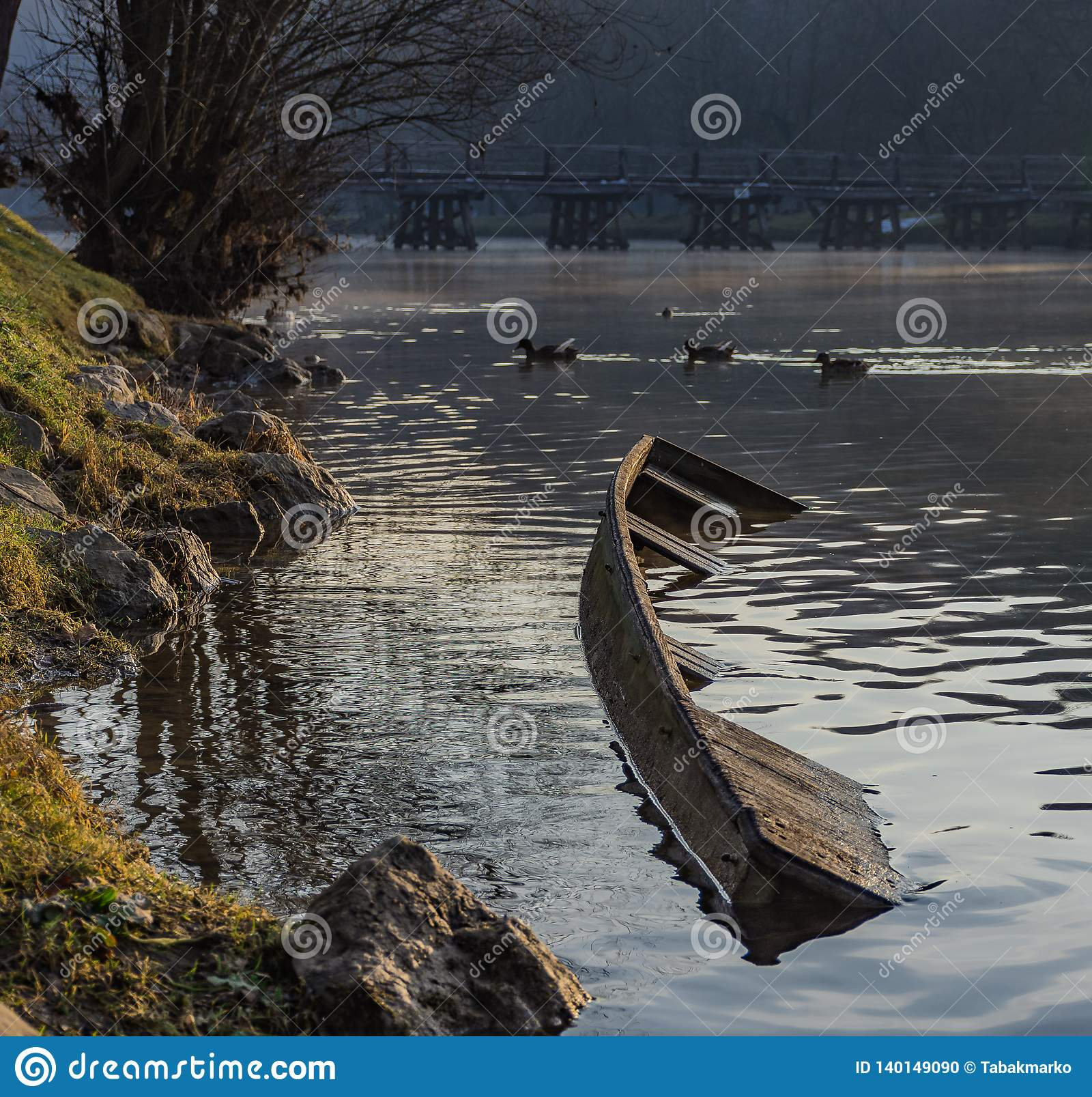 Sunken river boat on the coast of a river