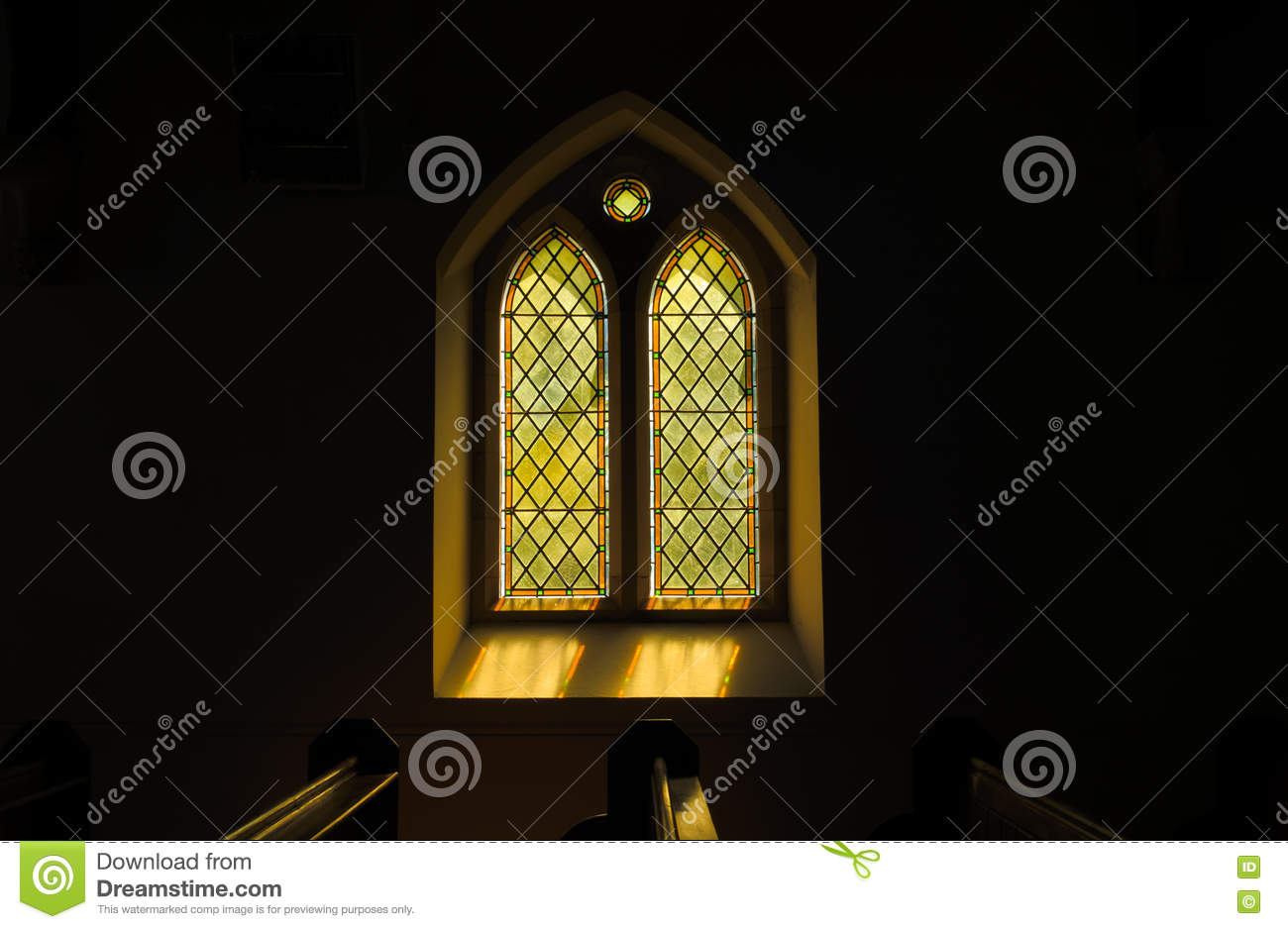 Sunlight Casting Colours Through Gothic Stained Glass Window Stock
