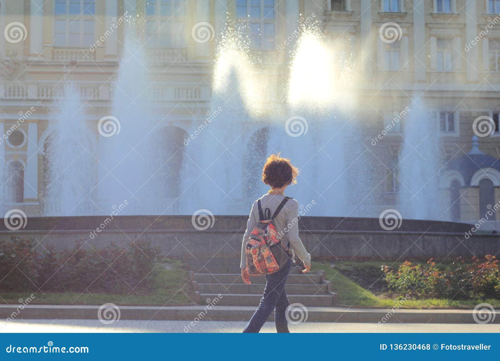 Sunlight coming through fountain water streams