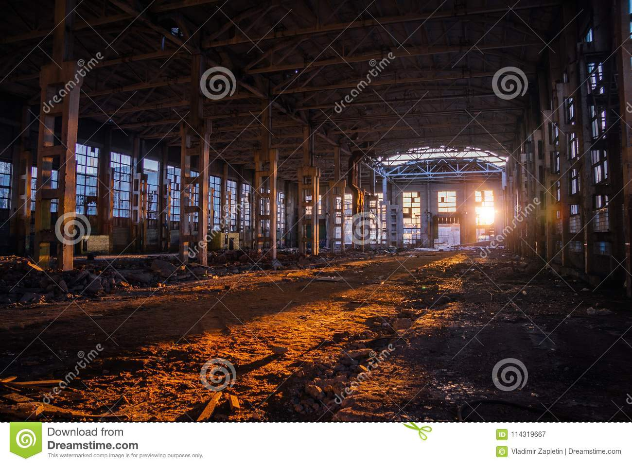 Sunlight of sunset in large abandoned industrial building of Voronezh excavator factory