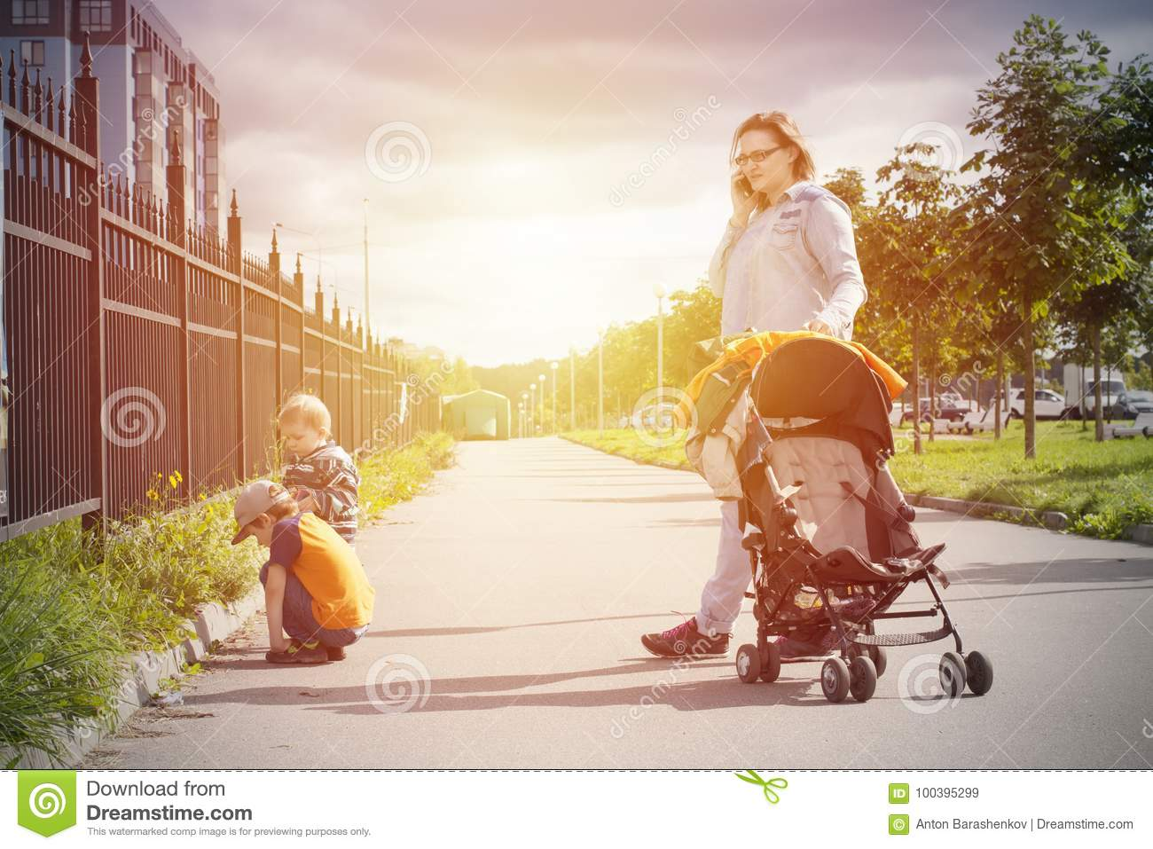 Sunny autumn family walking outdoor