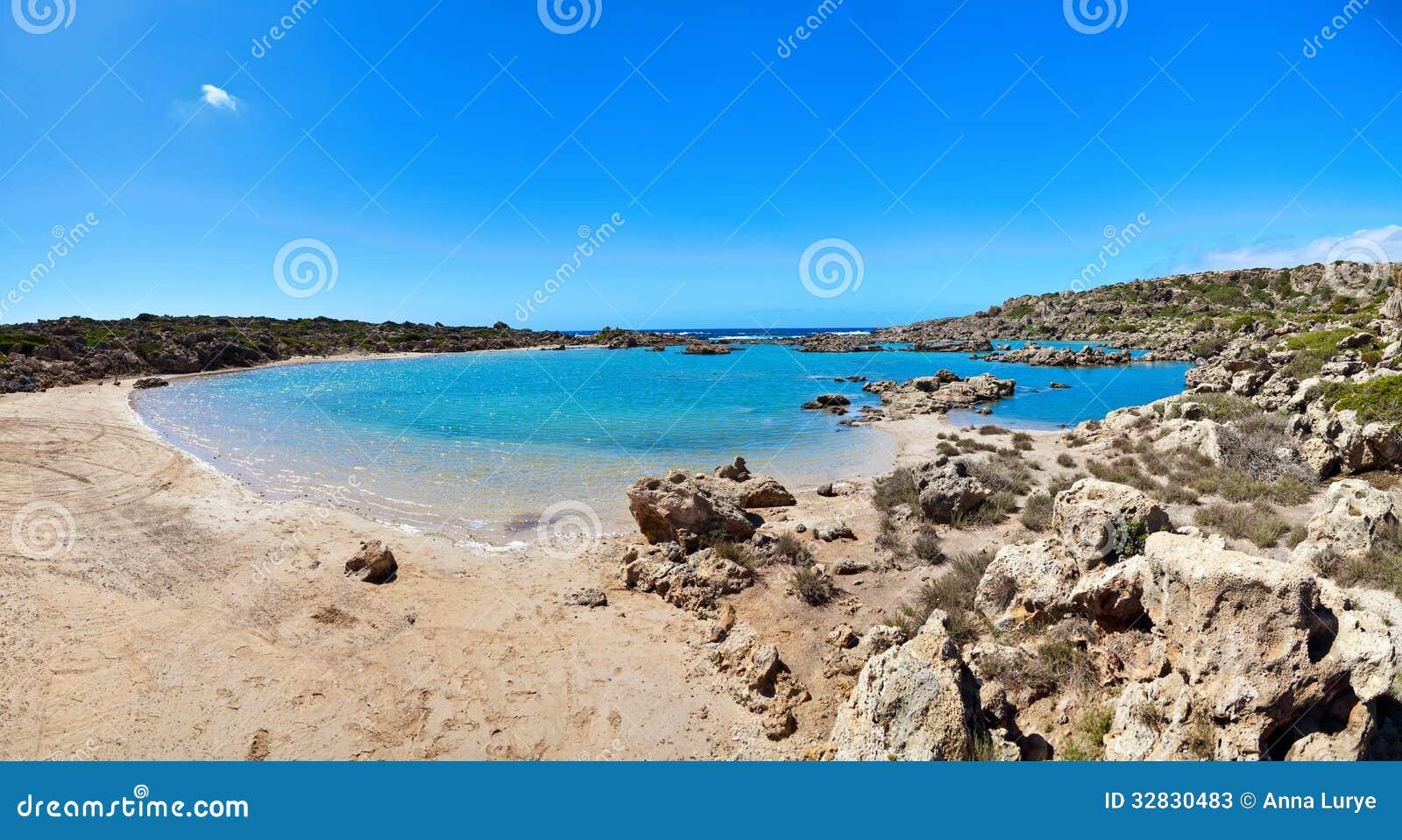 Beautiful sunny day with blue sky at Aspri Limni in Crete, Greece.