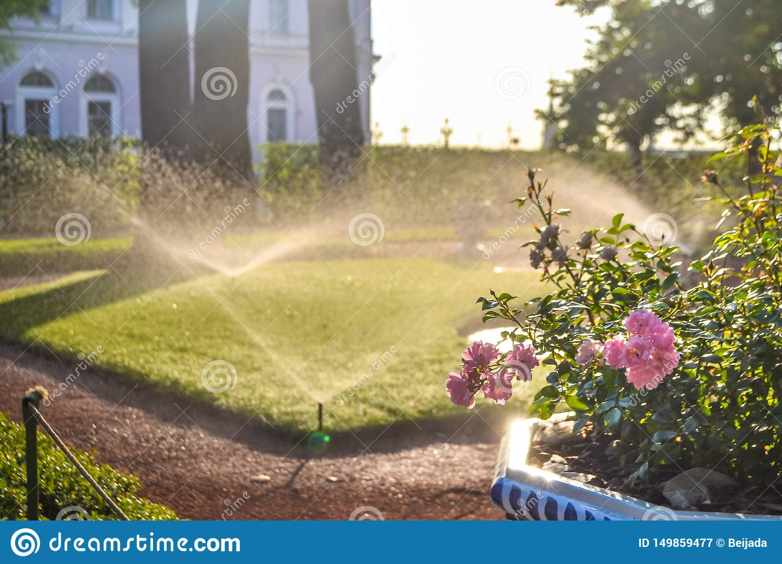 Sunny day and irrigation sprinklers at Summer Garden, St. Petersburg