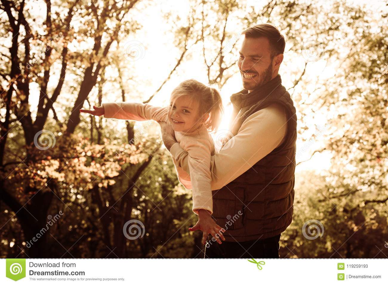 Sunny day in nature. Father and daughter.