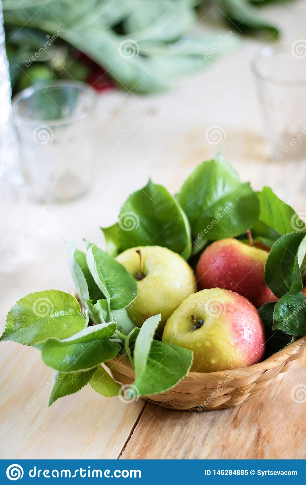 Still life of green apples in a basket on the table large flat