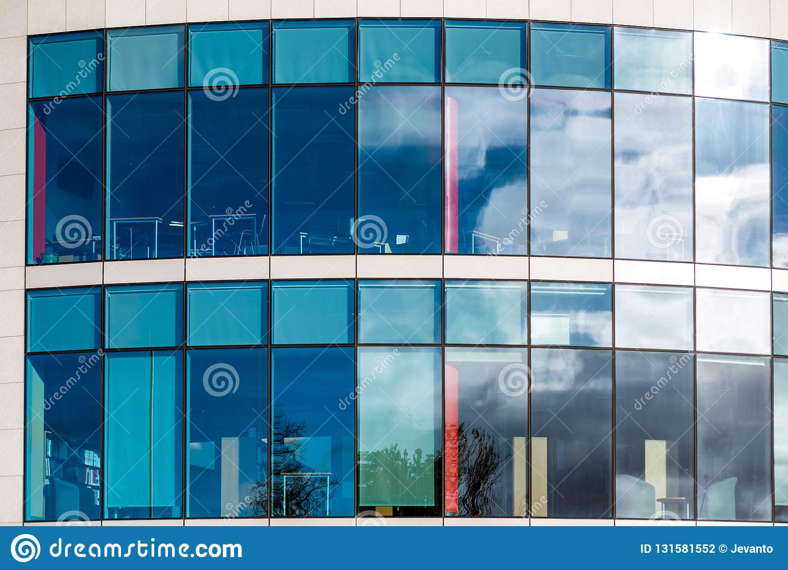 Sunny day view of windows of modern business corporate office building in northampton england uk