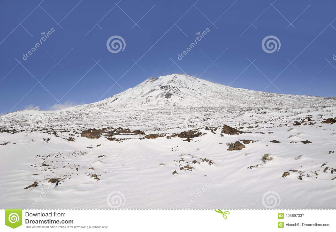 Sunny day with vistas towards Pico Viejo covered in snow in Teide National Park, Tenerife, Canary Islands, Spain