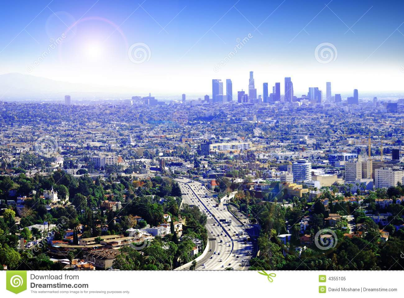 Another sunny day in Los Angeles, California as traffic drives by ...