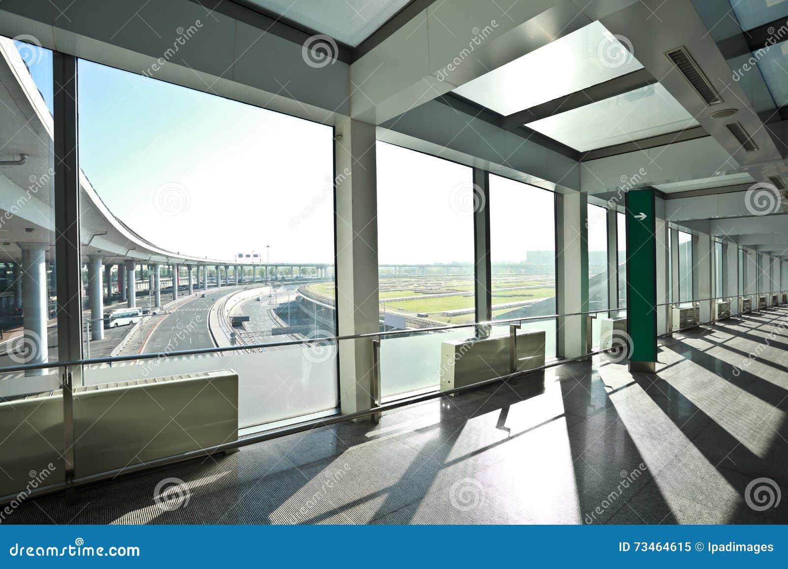 Sunny on modern glass office windows building interior for Modern office building interior