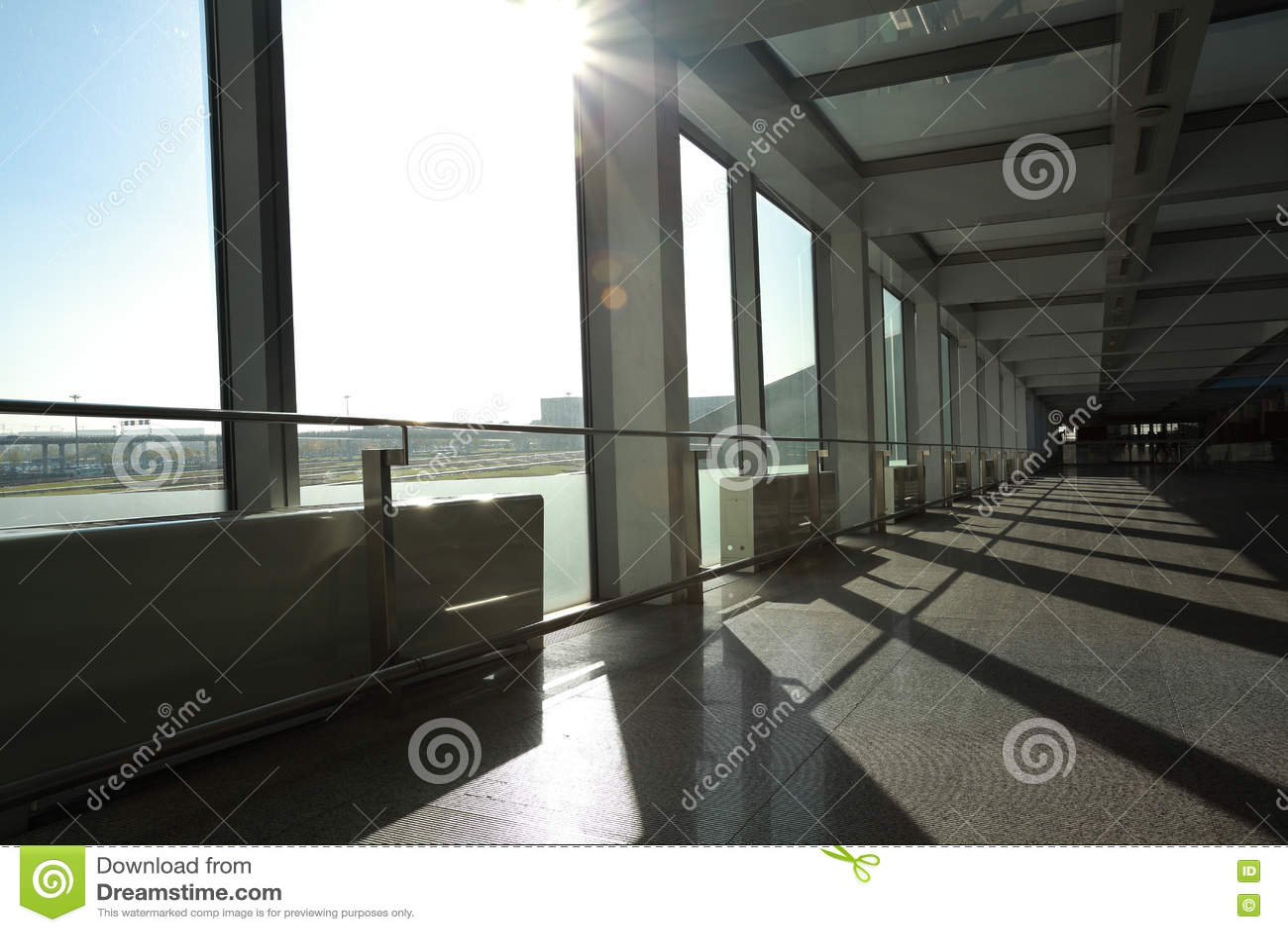 Sunny on modern glass office windows building interior corridor
