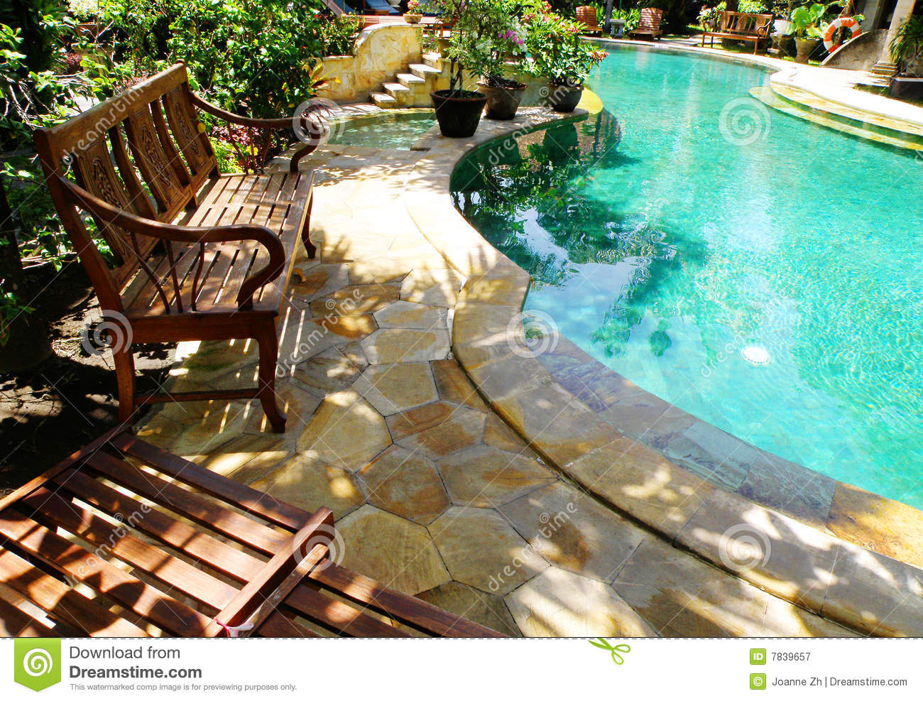 sunny outdoor swimming pool and patio furniture royalty