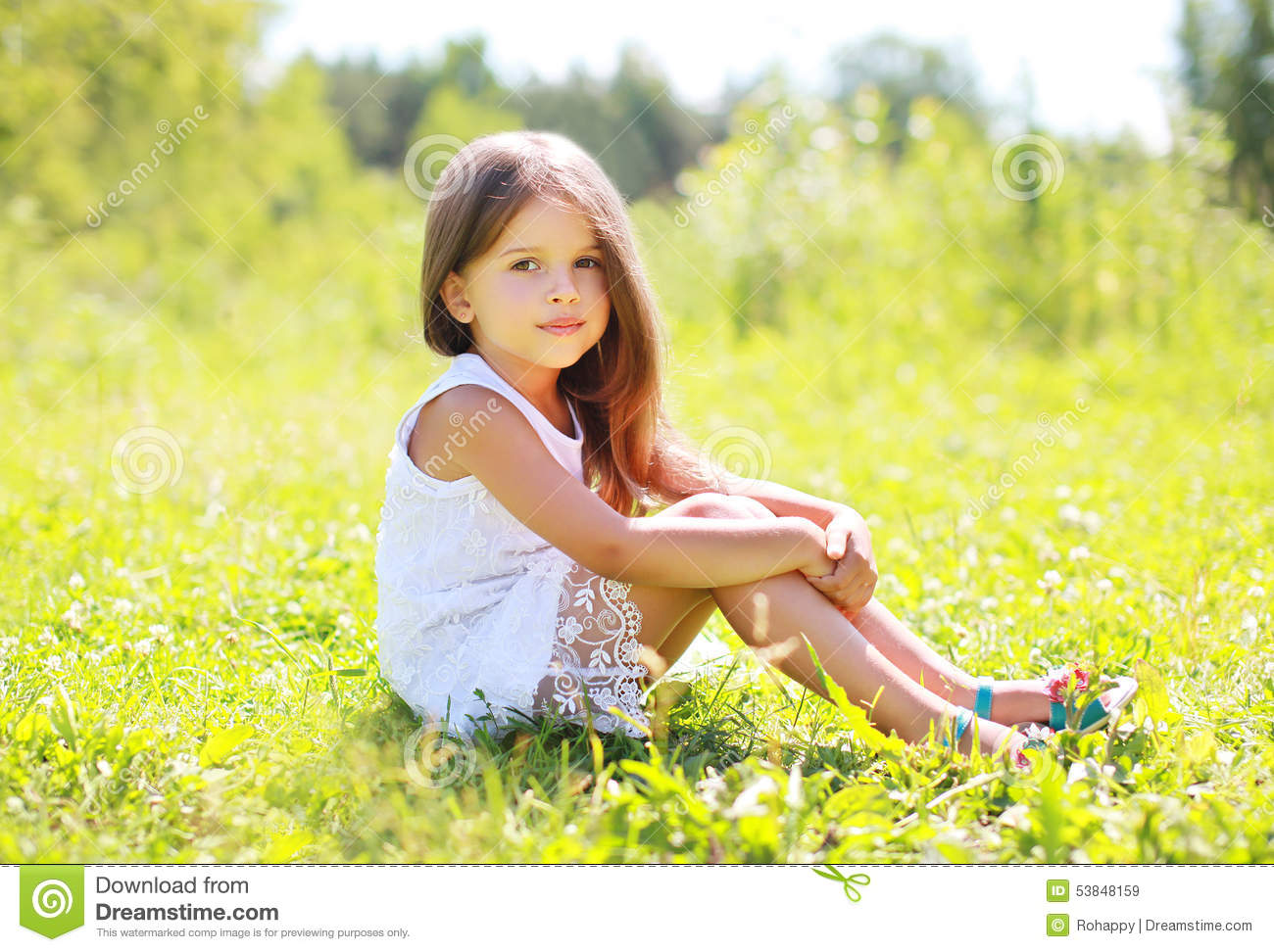 Sunny Portrait Of Beautiful Little Girl Sitting On The