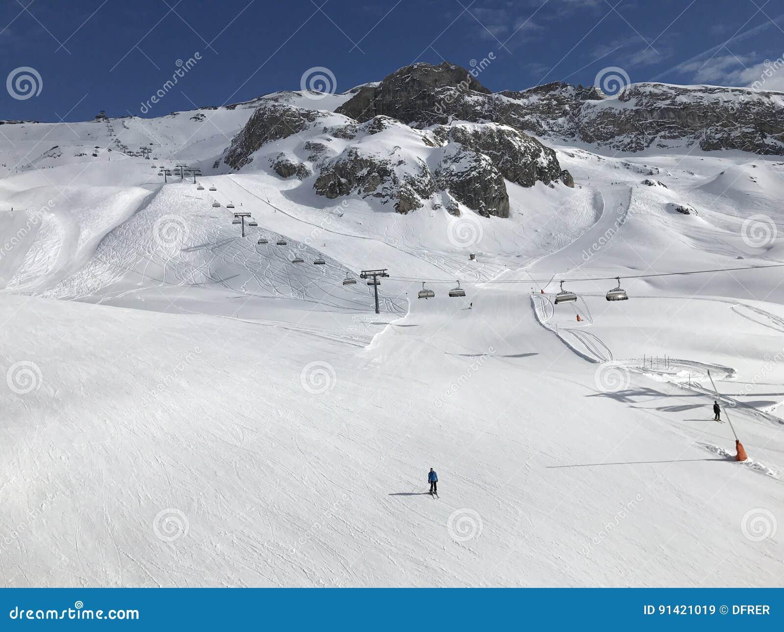 sunny ski slope with ski person at austria white snow stock image