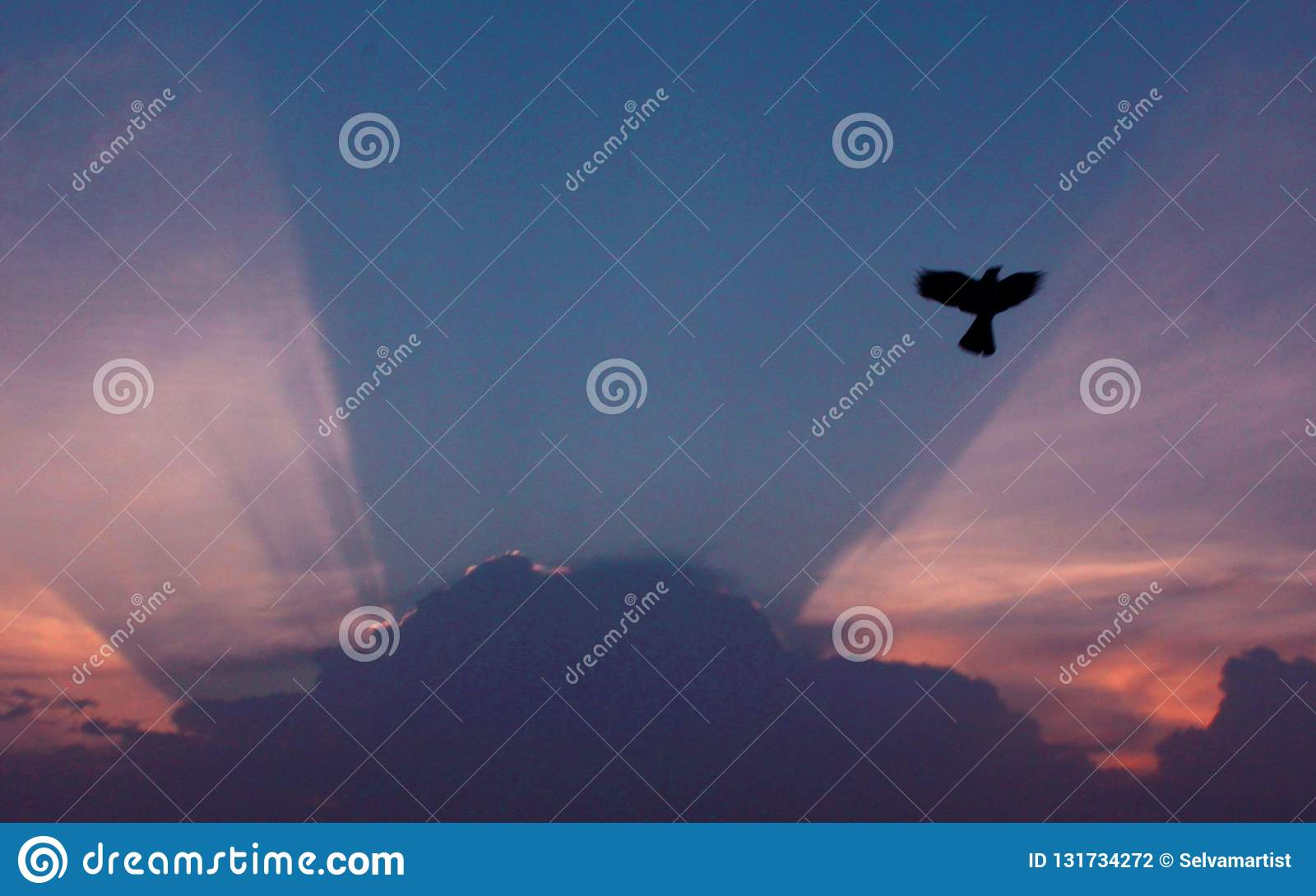 Sunrise and asunset with clouds and rays.