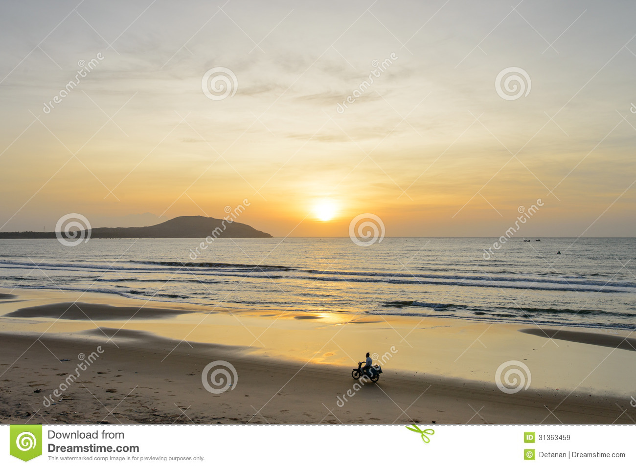 Ride motorcycle at sunrise on the beach