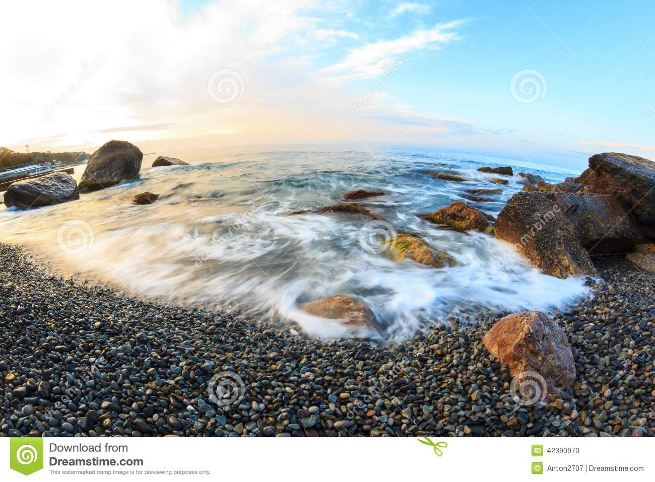 Sunrise on beach with rocks and sea stock photo image for Beach rocks for landscaping
