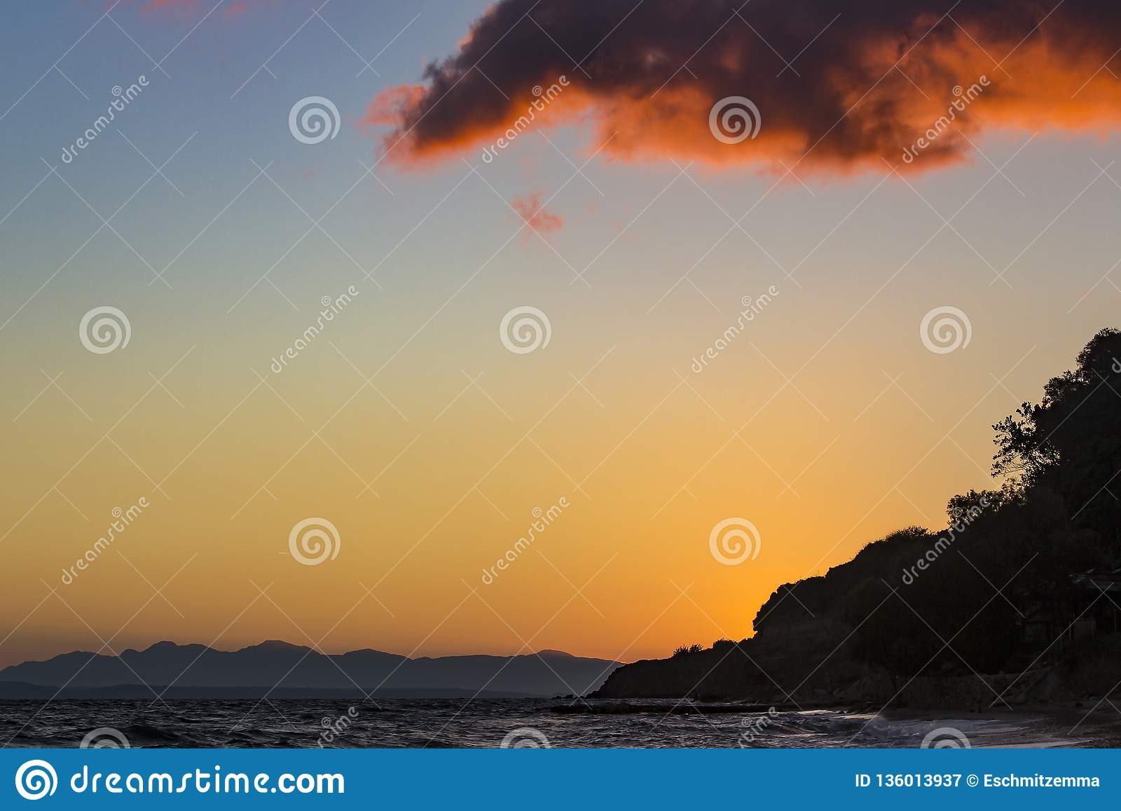 Sunrise with beautifully coloured sky and clouds near Tsilivi, Zakynthos, Greece