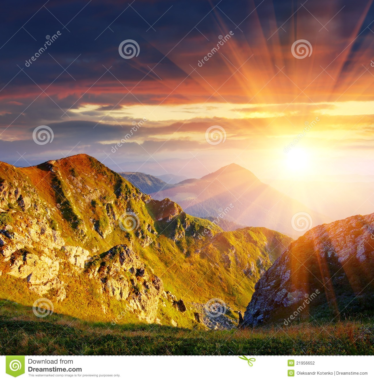 The first beams of a rising sun shine mountains Carpathians, Ukraine.