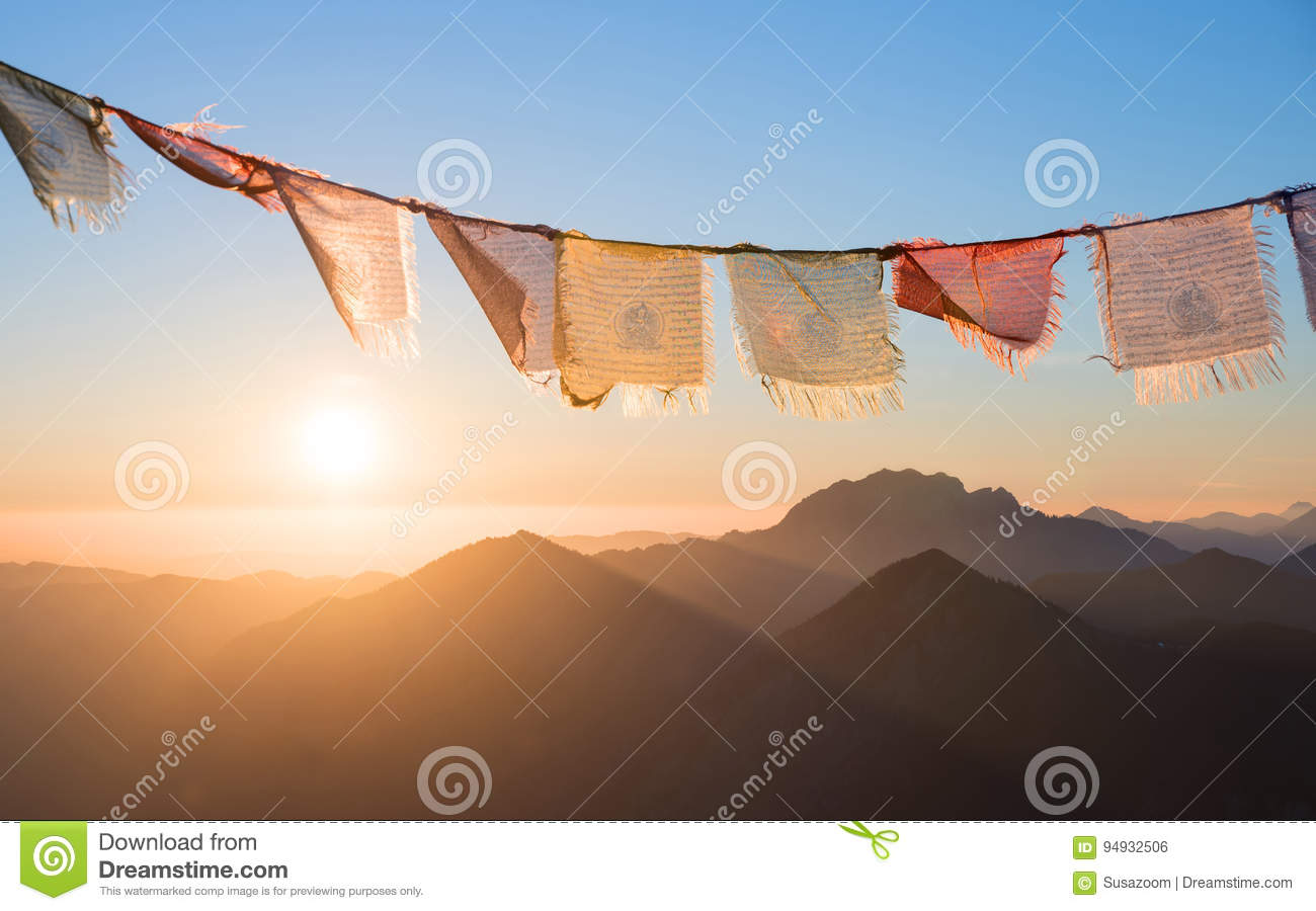 Sunrise in the mountains, colorful prayer flags