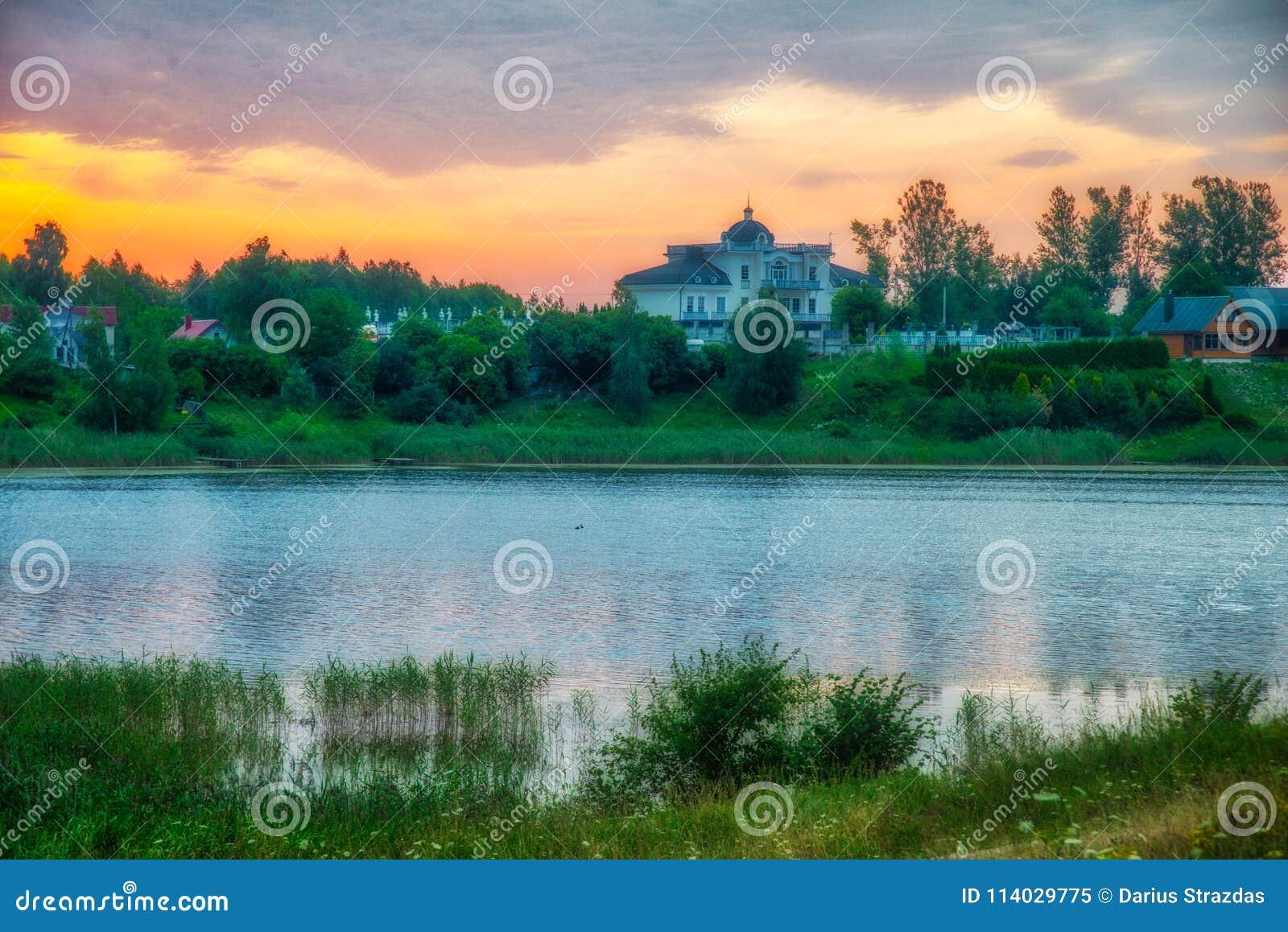 Sunrise near lake in summer