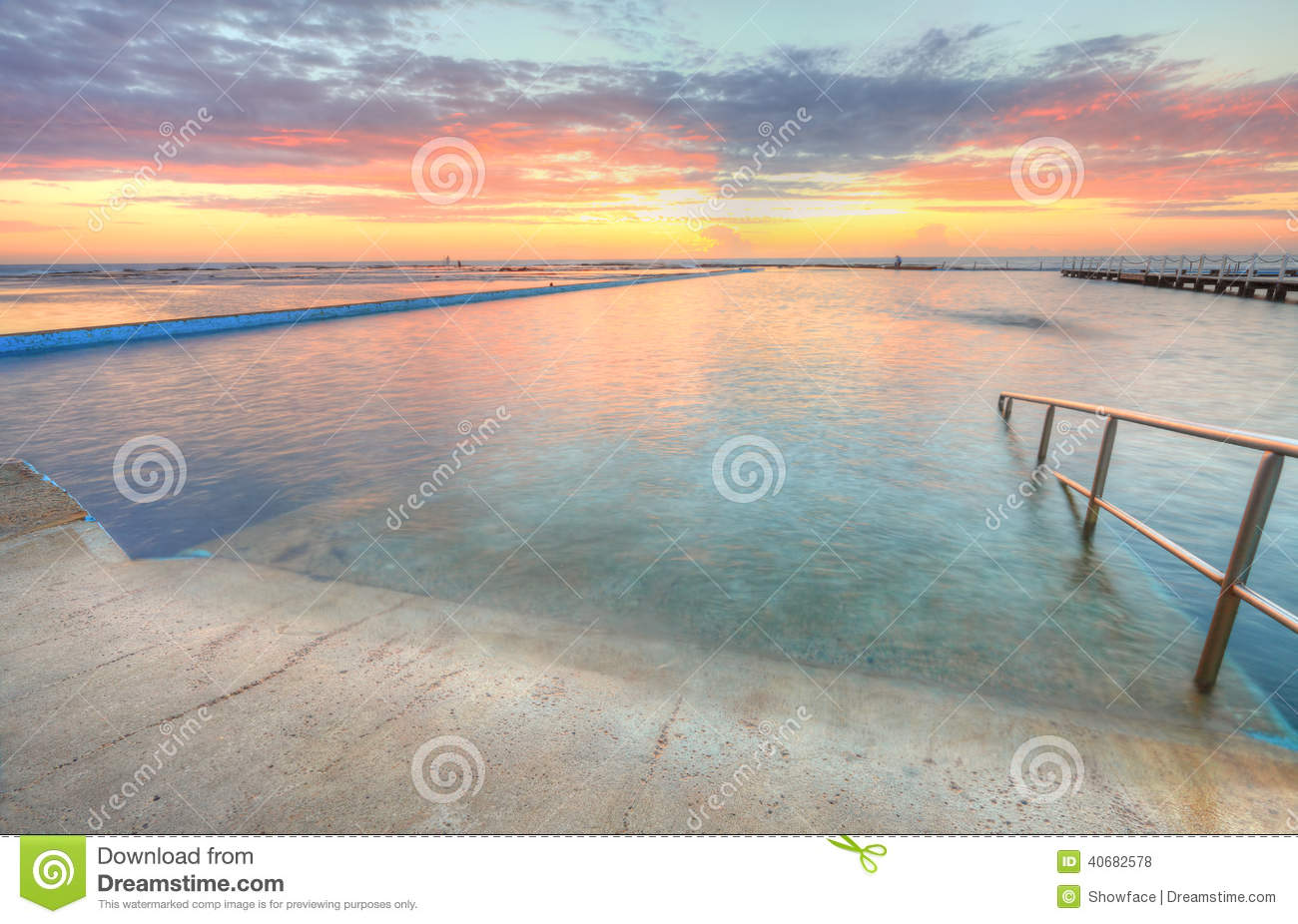 Sunrise from one of the pools to the ocean at North Narrabeen Au