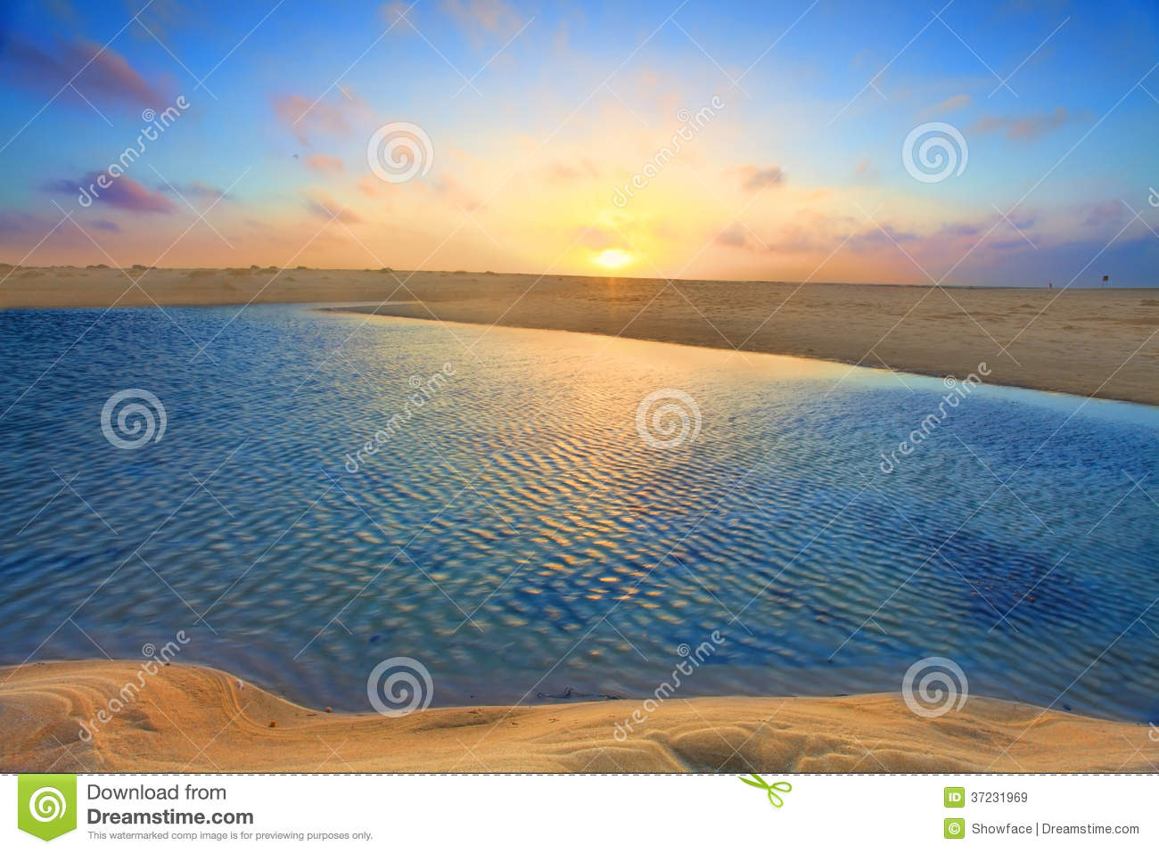 Sunrise over golden sands and azure waters