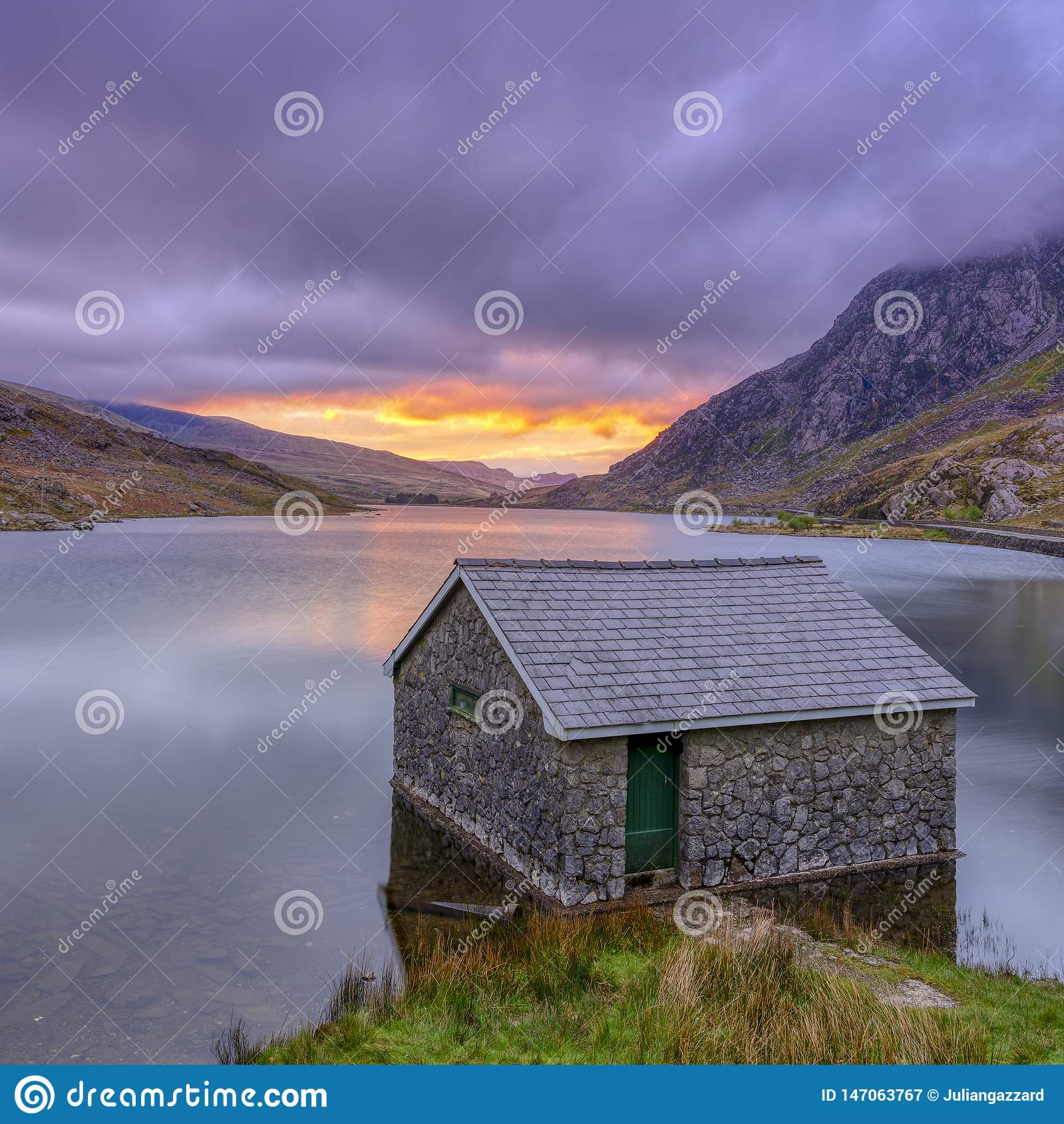 Sunrise over Llyn Ogwen and boathouse, Snowdonia National Park
