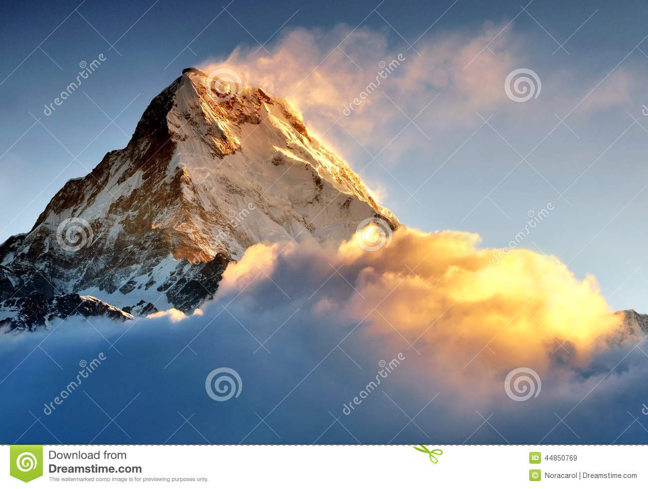 Sunrise over machapuchare or fish tail mountain stock for Peak fishing times