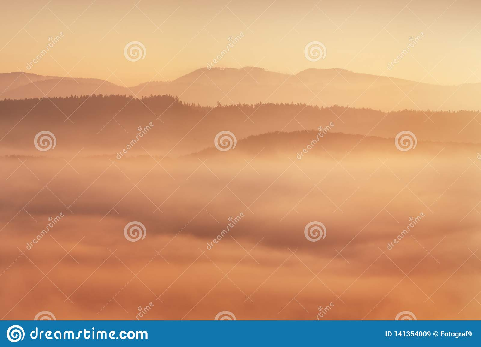 Sunrise Over Misty Landscape. Scenic View Of Foggy Morning Sky With Rising Sun Above Misty Forest. Middle Summer Nature Of Europe.