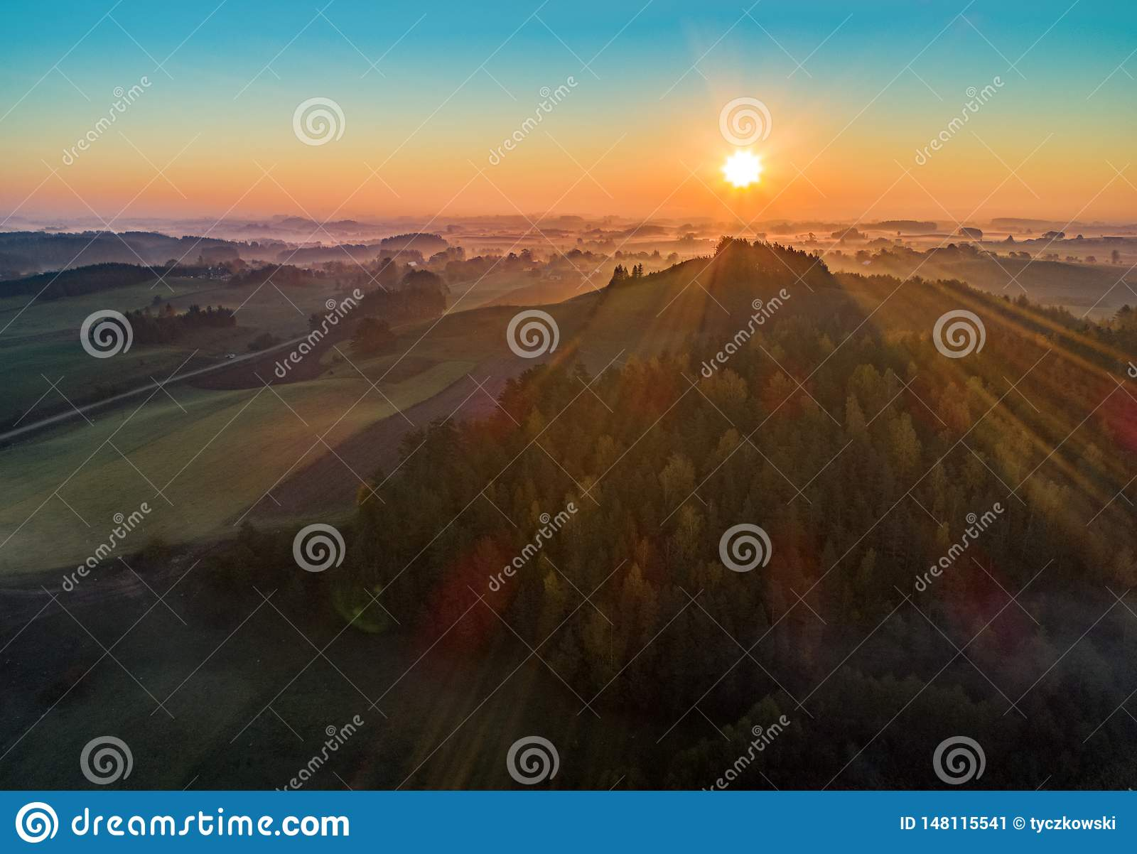 Sunrise over a mountain and forest - aerial photo