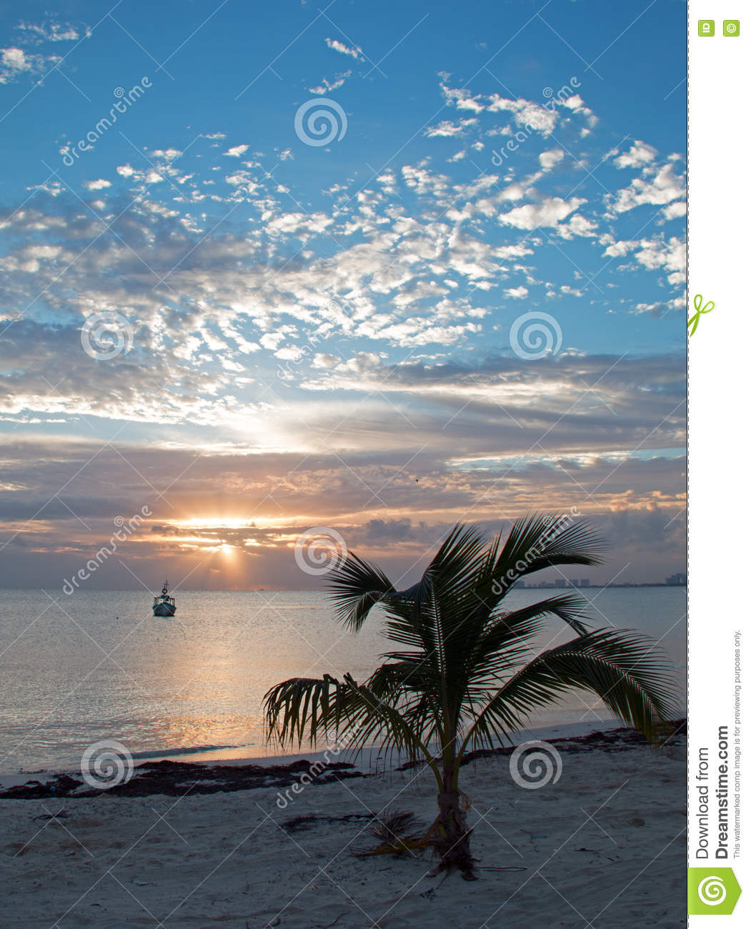 Sunrise over Puerto Juarez Bay, Beach, and fishing boat in Cancun Mexico