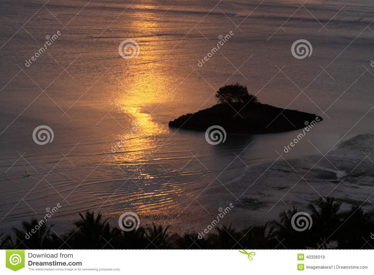 Sunrise reflections over a tropical island