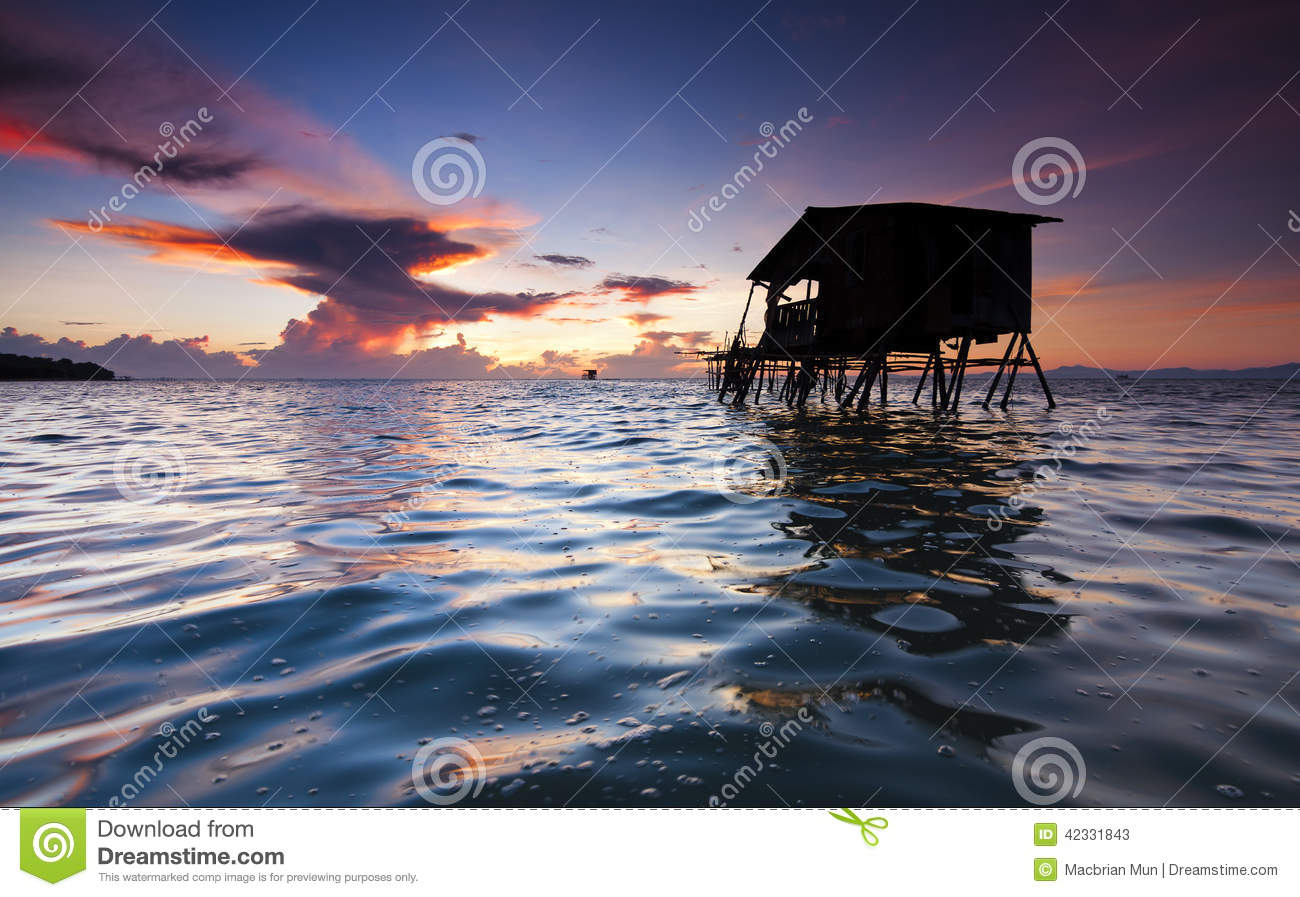 Sunrise with rippling water surface at Sabah, Malaysia