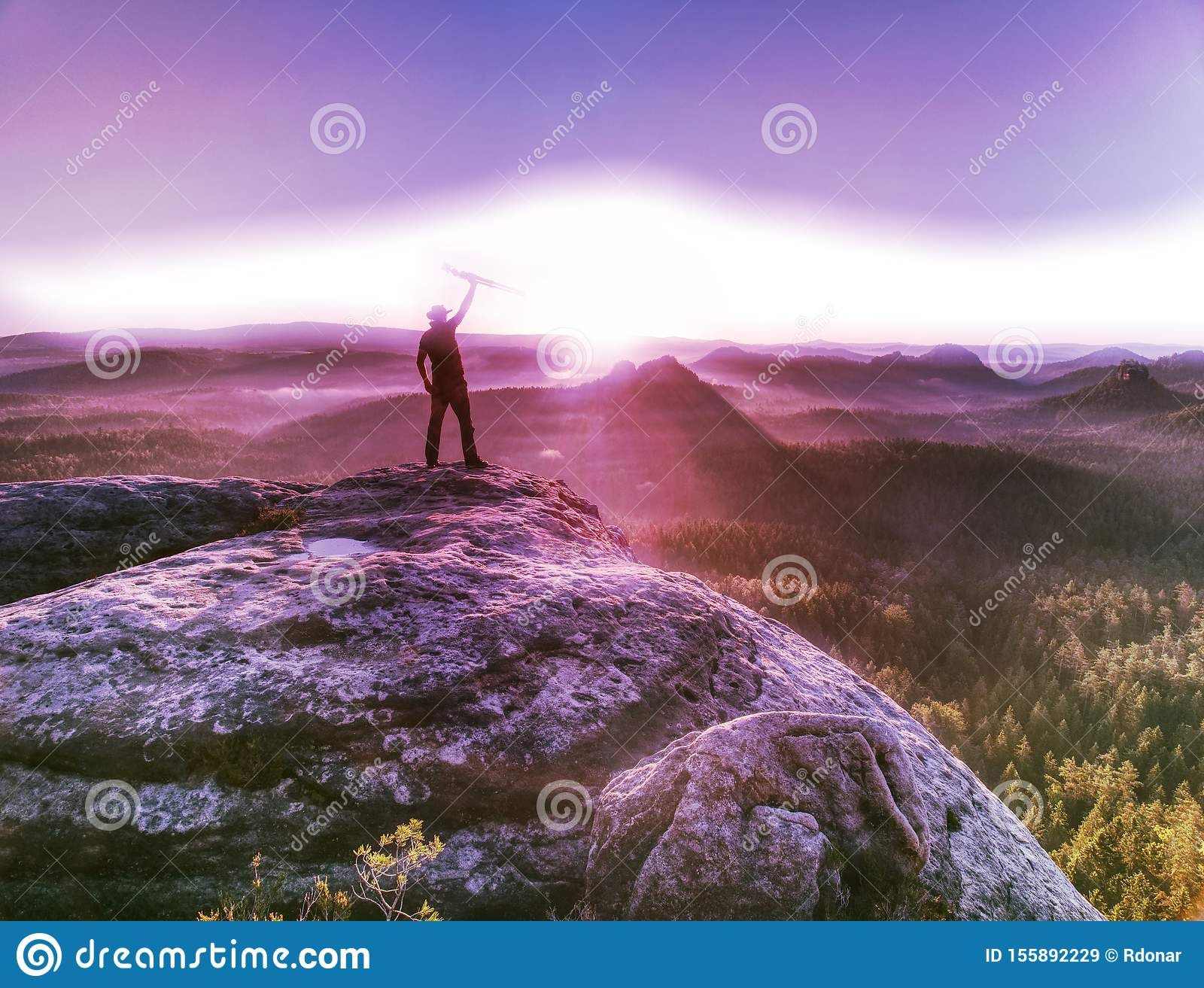 Sunrise on a rocky summit. Artist works in nature