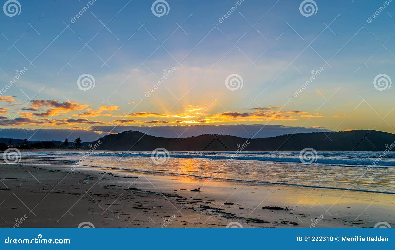 Sunrise Seascape and Crepuscular Rays