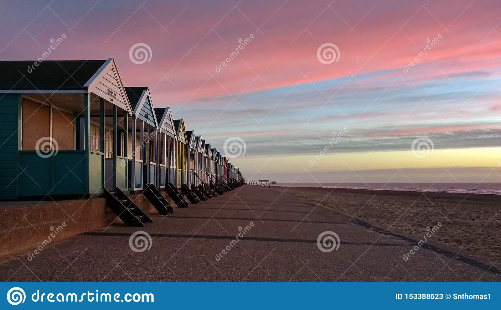 Sunrise shining on colourful beach huts in Southwold, Suffolk, England
