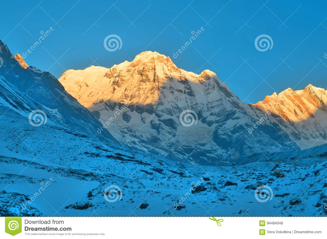 Sunrise in Snowy Mountain Landscape in Himalaya. Sun light. Annapurna South peak, Annapurna Base Camp Track.