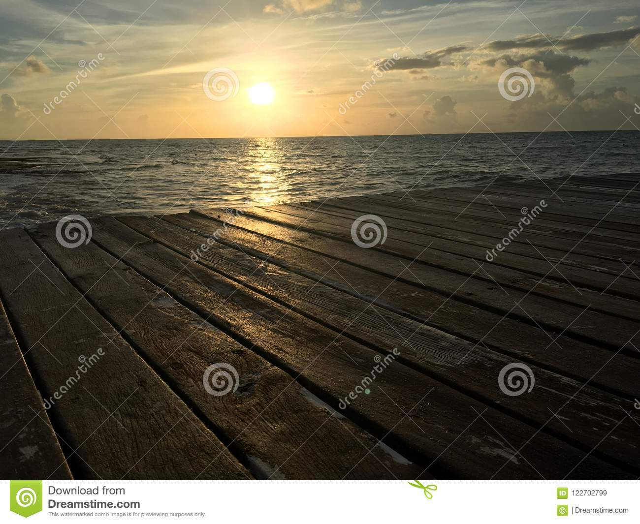 Sunrise sea water dock wood
