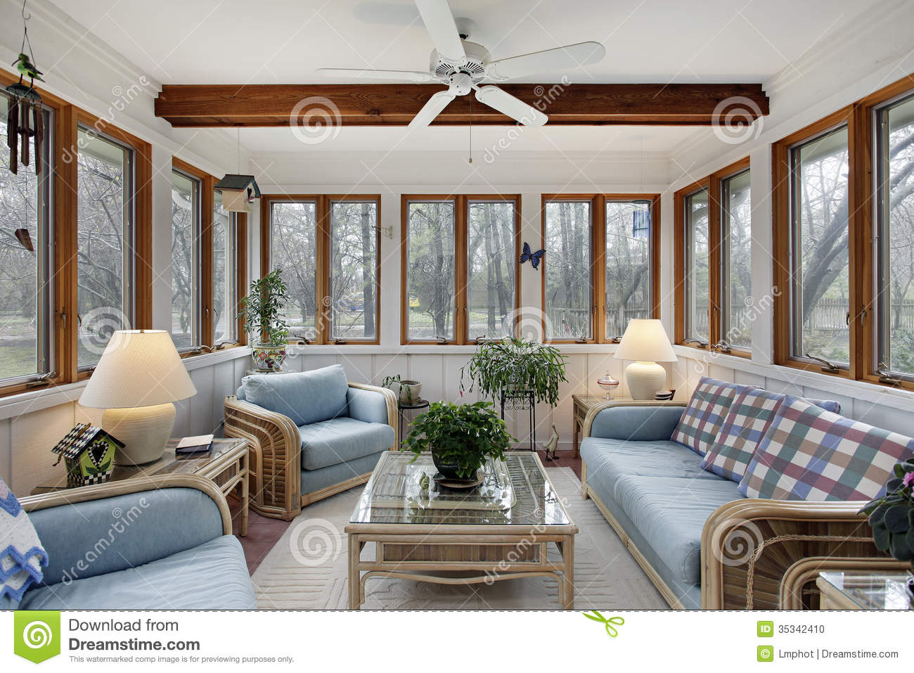 Zebra decor living room - Sunroom With Wood Ceiling Beam Stock Photo Image 35342410