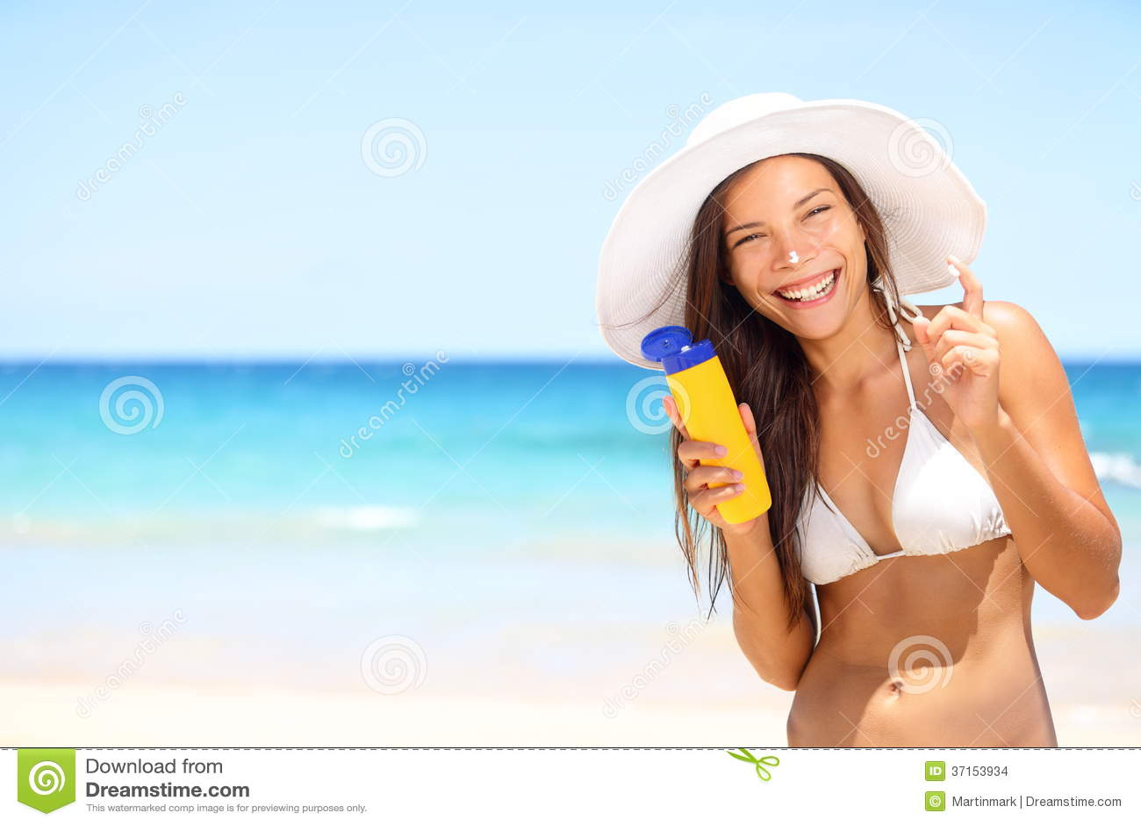 Beach applying sun cream 5