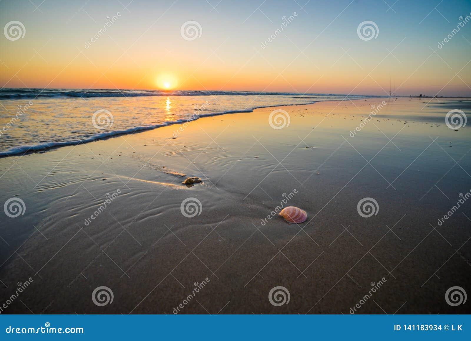 Sunset at beach in cadiz Spain