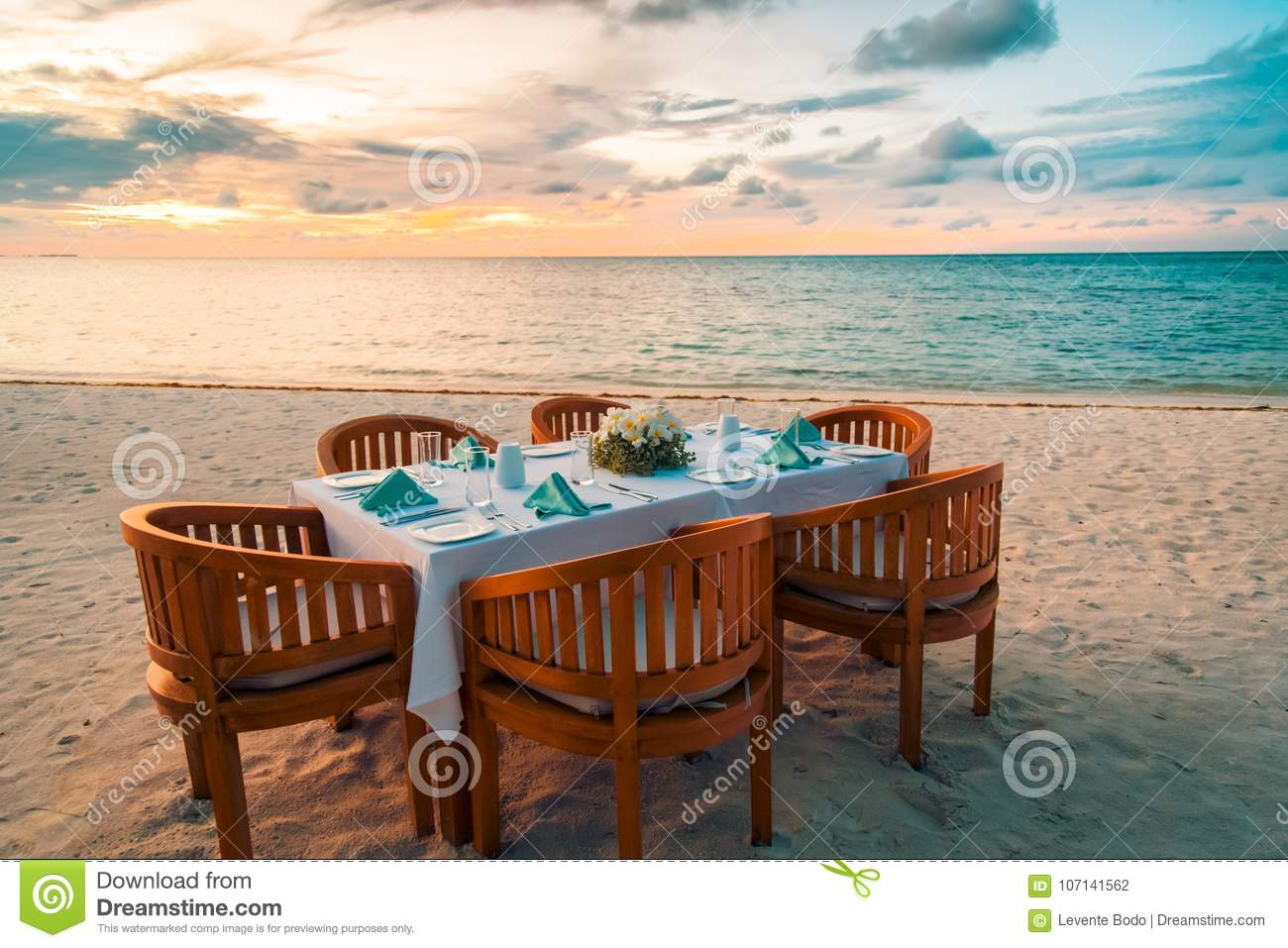 Download Beach Dinner Set Up For Couples Or Honeymooners. Sunset Beach  Scene With Wooden