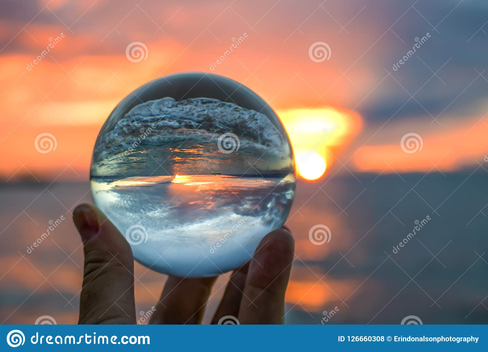 Sunset in Bright Orange with Wave Breaking on Sand Captured in Glass Ball