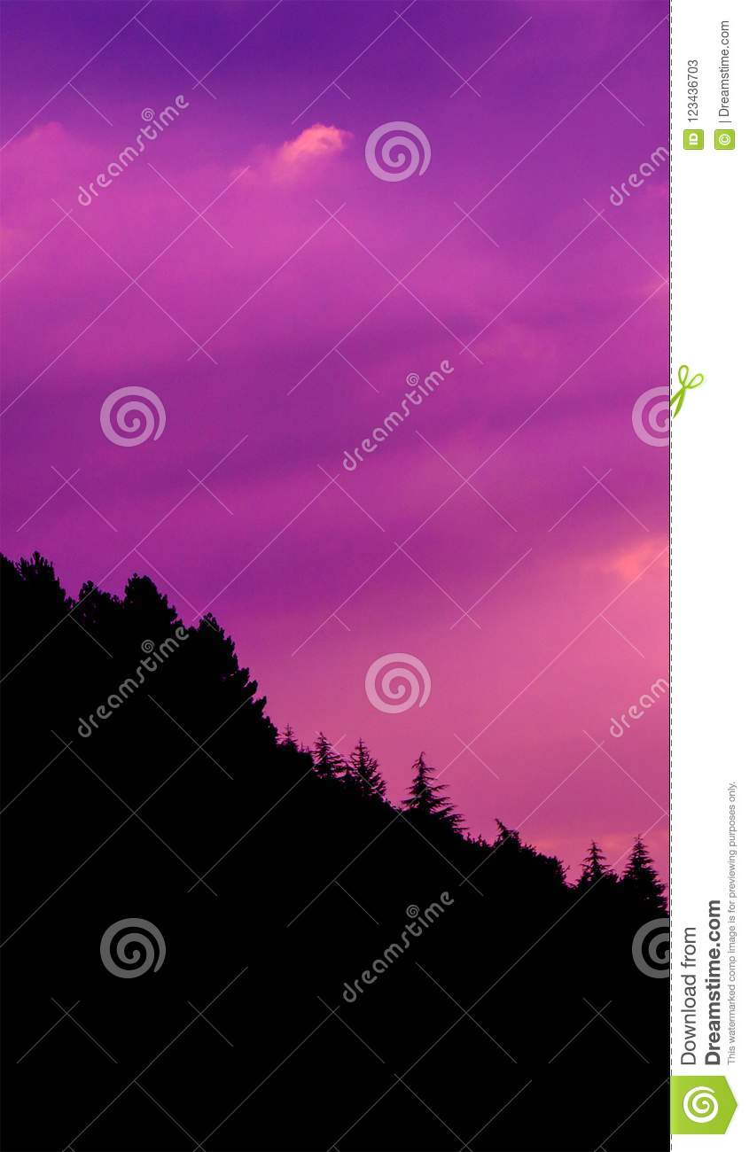 Sunset clouds photo with silhouette of pine forest at hill