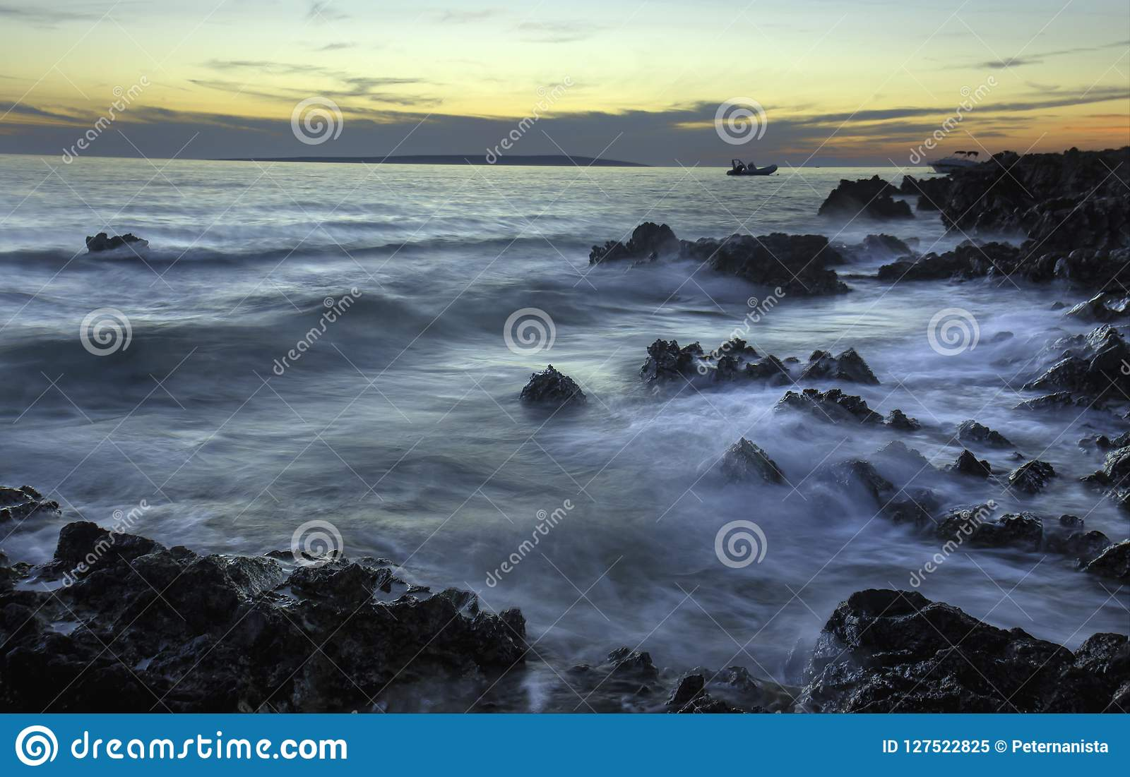 Sunset Coastline with Rocks and Ground Rush