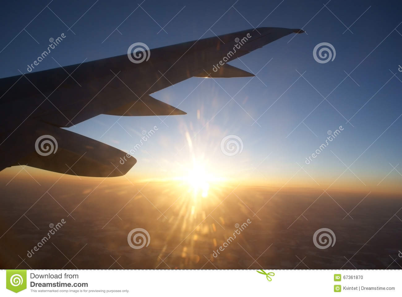 Sunset at the height of the air under the wing