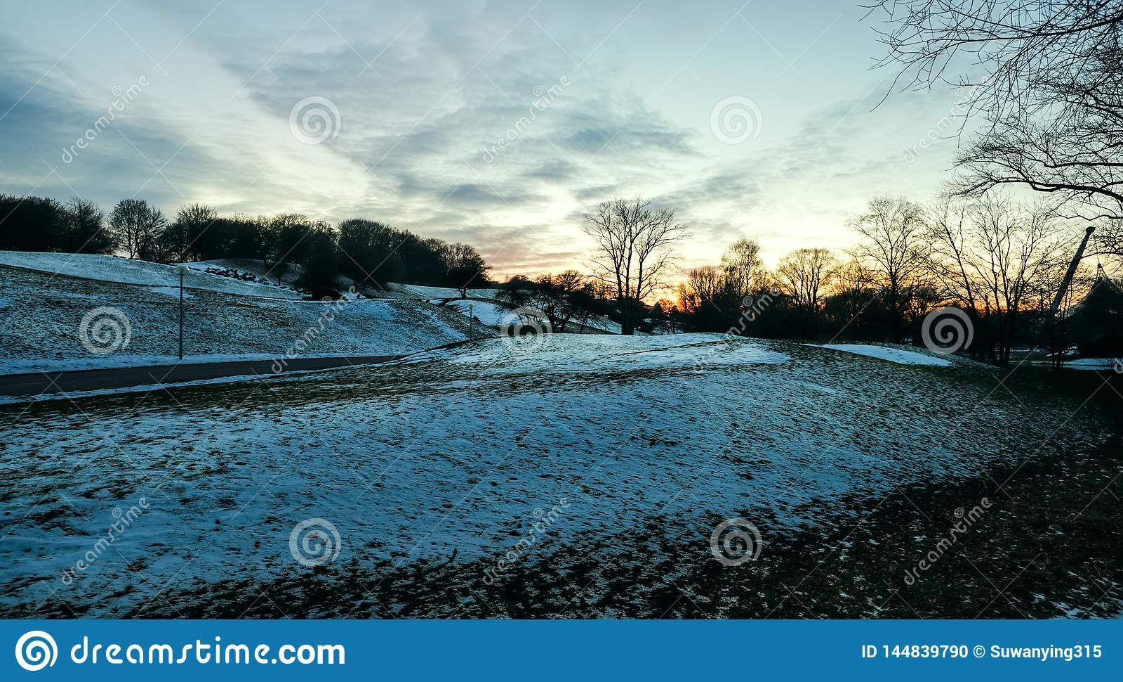 Sunset hillside in blue winter