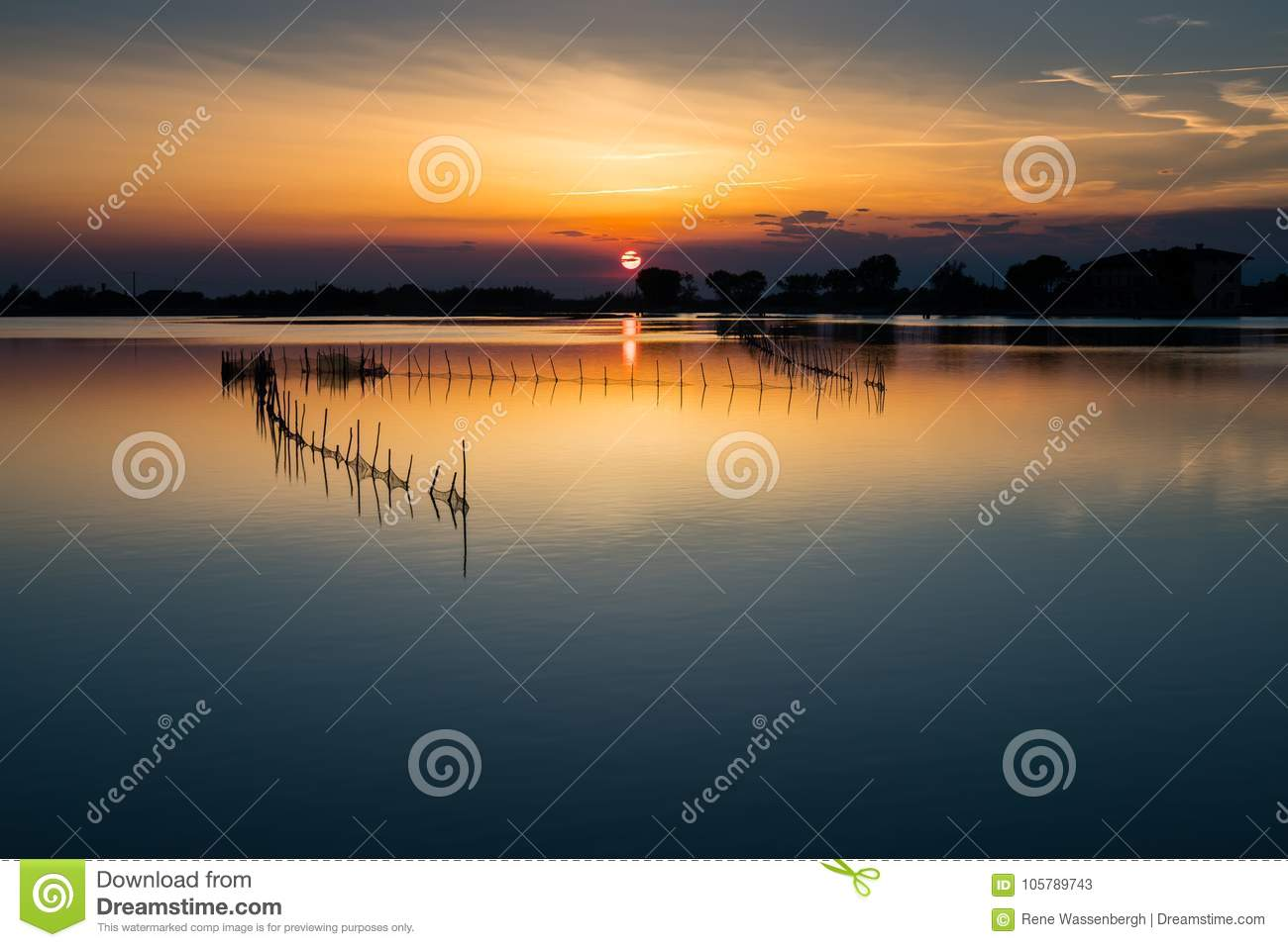Sunset at a lake in italy stock image image of silhouette for Can fish see water