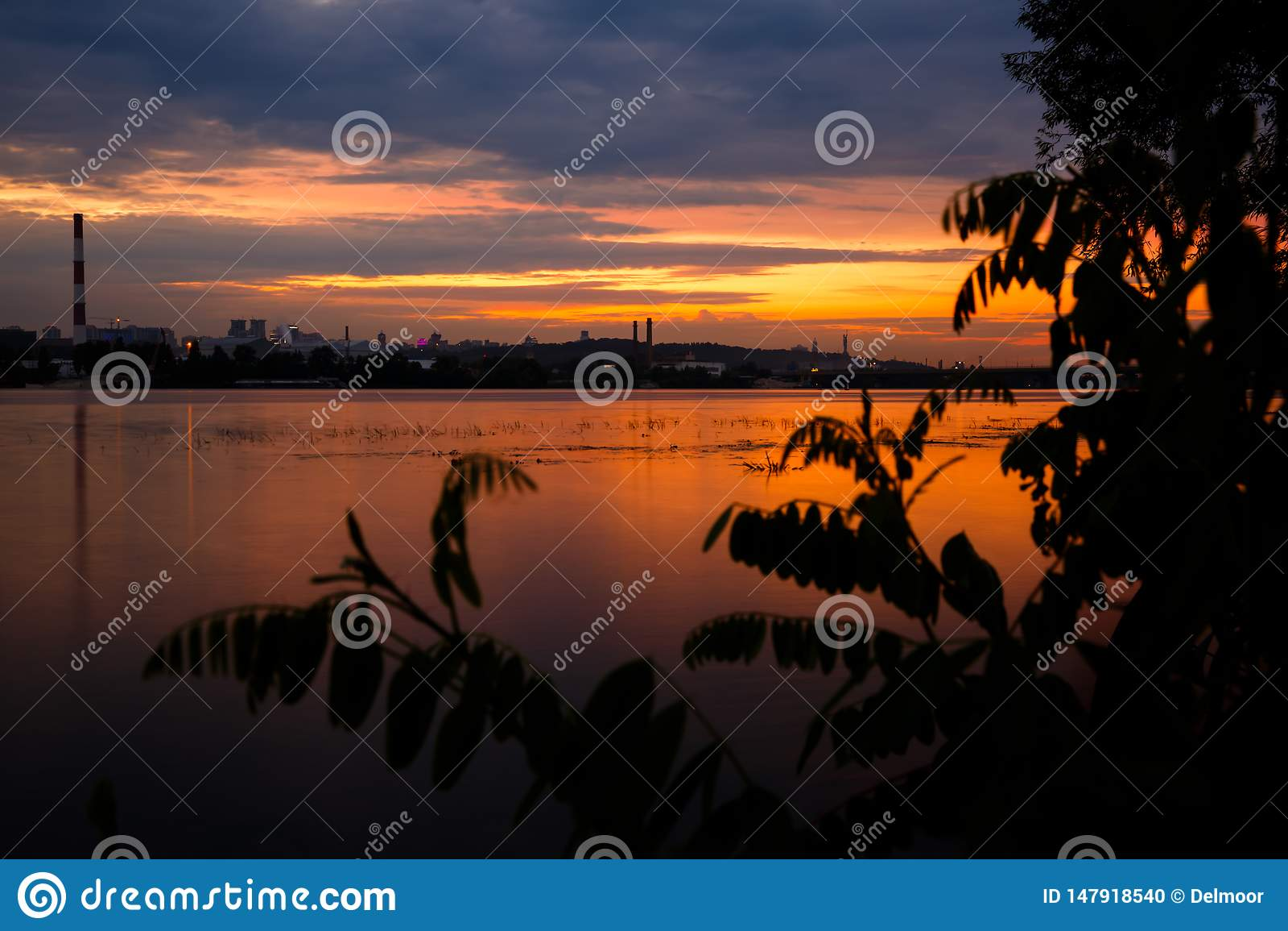 Sunset landscape over Dnipro river against Kyiv cityscape